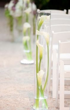 lily in bottle beach wedding aisle