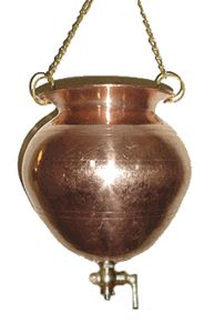 beautiful copper shirodhara pot is hand hammered in India.