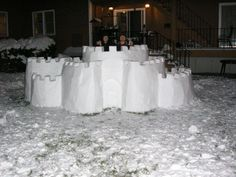 Snow Castle: Decided to put this together one night, sorry for only finished pics, but we weren't thinking about it until after! Really the only way to carve a proper castle! Snow Castle, Western Christmas, Snow Sculptures, Ice Castles, Snow And Ice, Winter Fun, Outdoor Play, First Night, Winter Wonderland