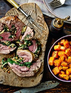 // Roast shoulder of lamb with Moroccan-spiced spinach stuffing.