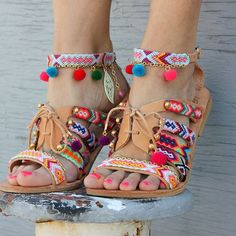 Soak up this summer with the eye-catching Betty Boop sandals. Decorated with friendship bracelets, multicolored pom poms and beads, these sandals add a playful spin to any outfit. What would you wear with them? #sandals #madeingreece #dimitrasworkshop #bettyboop #happyfeet #shoeporn #instagood #monday #bohemian #pompomsandals #fashionista #handmade #wanderlust #summerwear #shoes #women #bohoshop #stylish #chic #friendshipbracelet #beachwear