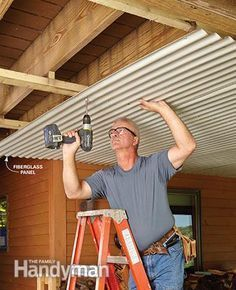 How to Build an Under-Deck Roof 2019 Screw the fiberglass panels that form the under-deck roof to the purlins. This will be great for a shed to stay dry under the deck. The post How to Build an Under-Deck Roof 2019 appeared first on Deck ideas. New Deck, Back Deck, Lower Deck, Under Deck Roofing, Under Deck Ceiling, Patio Ceiling Ideas, Low Ceiling Basement, Porch Ceiling, Second Story Deck