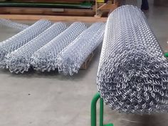 One metal coil curtain roll in silver color is put on the metal frame. Four…