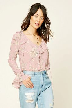 Contemporary - A woven top featuring an allover floral print, ruffled neckline, self-tie straps, and long bell sleeves.