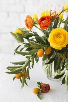 APRIL RULES  tulips, lilacs, ranunculus, daffodils, feverfew, wax flower, lavender, and kumquats