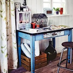 Conservatory with rustic blue table