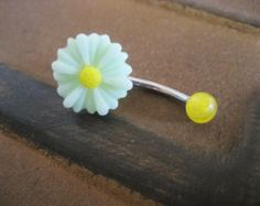 I need to get this navel ring! White daisy non-dangling belly button piercing.