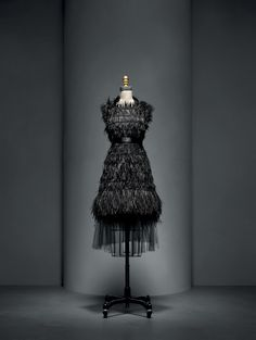 House of Chanel (French, founded 1913). Karl Lagerfeld (French, born Hamburg, 1938). Dress, autumn/winter 2015–16, Haute Couture. Hand–sewn black silk tulle, hand–embroidered by Lemarié with black crystals and black silk passementerie hand–woven with hand–glued and –stitched black ostrich feathers.  Photo © Nicholas Alan Cope. #ManusxMachina #CostumeInstitute