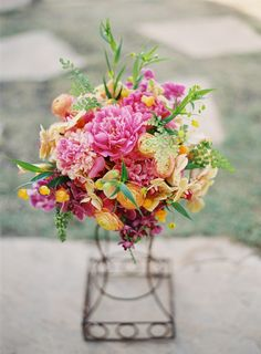 A lush and vibrant bouquet of peonies, orchids, ranunculus, dahlias and ferns  Flower Chic: Pink & Orange Tropical Bouquet with Modern Day Designs
