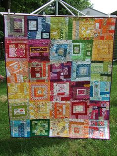 #rainbow #quilt made with wonky log cabin blocks as well as other scrappy blocks