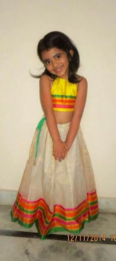 Yellow and white chanderi lehenga with bright coloured stripes for girls. Kids Indian Wear, Kids Ethnic Wear, Indian Baby, Little Dresses, Little Girl Dresses, Girls Dresses, Baby Girl Fashion, Toddler Fashion, Kids Fashion