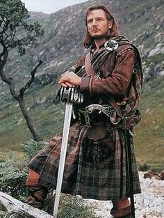 """Liam Neeson portraying Rob Roy wearing the large kilt, of filleadh mór - """"It's a kilt.  If I wore something under it THEN it would be a skirt""""."""