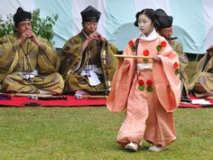 Men and a boy who has his hair up in the heian era juvenile style at a Kyokusui No En poetry party.
