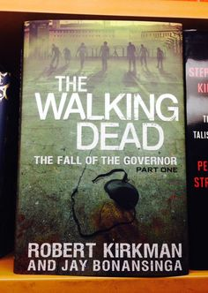 Most people know The Walking Dead for its television series as well as the graphic novels that started it all. But there's also a book series! And this here, THE FALL OF THE GOVERNOR: PART ONE by Robert Kirkman, is the newest title. Find it in our Horror section. #WalkingDead #zombies #halloween