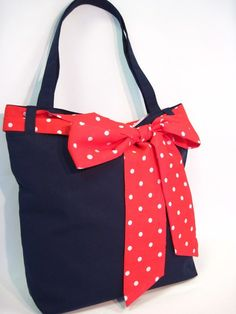 Whether you're carrying books, groceries or a picnic, this tote bag is perfect for the girl who likes to combine the pretty and practical. Made of hard-wearing navy blue drill fabric and lined in pale lilac polycotton. Bow Scarf, Artist Bag, The Girl Who, Shopping Bag, Diaper Bag, Lilac, Navy Blue, Bows, Shoulder Bag