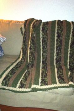 Thick and thin throw, pattern from Red Heart site.  I used my own color combination for my grandson Sean.  He likes camouflage and the Red Heart camo yarn turned out beautiful!
