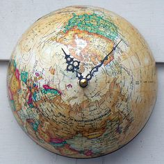 Globe Clock.  Just so happens my globe is broken in half!   Cute for the boys room.