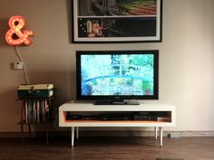 What a difference a new pair of legs can make! via Heather for IKEA Hackers: Mid-Century Lack TV Hack