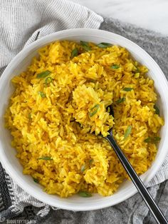This savory Yellow Jasmine Rice combines warm and fragrant Indian spices and chicken broth to make the most flavorful rice you've ever tasted! BudgetBytes.com