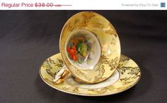 Hand Painted Yellow and Gold Pedestal Teacup and Saucer Vintage Old Gold Japan Birds Fruit Flowers