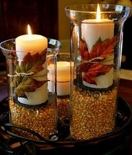 Purchase a glass cylinder from a local hobby store fill bottom with popcorn seeds or dried corn, a pillar candle in the color of your choice, and a fall leaf then your done!!!