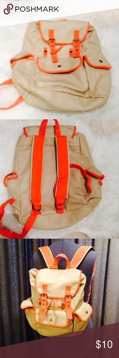 NWOT drawstring backpack NWOT drawstring orange backpack, numerous pockets inside and out Mossimo Supply Co. Bags Backpacks