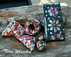 Mosaics made with eggshells and poly clay.  Poly clay pendant made  with stencils.  By terri Wlaschin