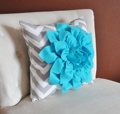 if you got two pink pillows I would get one of these and put it in the middle front (or the smaller one)