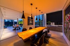 House in Londrina by Spagnuolo Arquitetura - great table and pendant lights