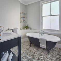 Monochrome-bathroom-with-patterned-tiles-and-roll-top-bath. Acheive this look with the Prodigg cast iron bath Rosenheim and the Idube freestanding vanity. Bathroom Floor Tiles, Bathroom Wall Decor, Bathroom Colors, Bathroom Styling, Bathroom Sets, Bathroom Interior Design, White Bathroom, Master Bathroom, Bathroom With Shower And Bath