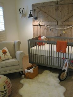 Barn door becomes the backdrop for the crib.