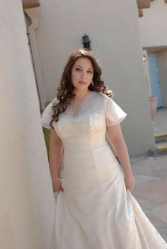 This gorgeous bride, Samatha, needed a wedding dress with sleeves for a religious ceremony. She also wanted a light, airy dress. The solution -  these dreamy sleeves, made from layers of transparent silk.