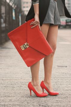 Gigantic red clutch. Matching red shoes. I would add matching red fingernails.
