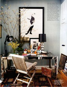 Stylish, Chic, Home Office, Trendy, Metal and glass Desk, Plants, Wood patio chair, grey walls, Wall art, Contrasting Patterns.