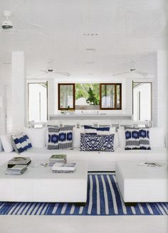 and blue-the best combo-I like the clean lines of the furniture & white background with the geometry of the blue & white prints & rug