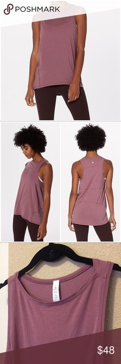 """Lululemon Back in Action Tank Top 6 Figue Pink Lululemon Athletica Back in Action tank top. Size 6. Color: figue - a gorgoeus dusty mauve pink. New w/out tag. No flaws. Washed once in cold water & hung to dry right after purchasing, but never worn. Muscle tee style. Relaxed fit. Made of soft, movement-friendly pima cotton & lycra. Slightly longer length. Great for yoga, running, training, dance & casual days. Approx 18.5"""" across the underarms & 28.5"""" long from shoulder to back bottom hem…"""