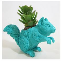 Love these planters made from old toys.