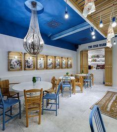 "At Fish Market, a seafood restaurant in Limassol, Cyprus by @MinasKosmidis, fishing references range from the net repurposed to encase a chandelier to the lightbulbs used as ""bait"" on iron hooks bobbing overhead. : Studio Vavdinoudis-Dimitriou. @sandow #architecture #interior #design #interiordesign #dining #restaurant #color #fishing #cyprus #limassol"