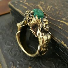 Antiqued brass Gemini ring with vintage malachite sphere.