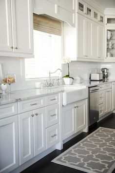 "Benjamin Moore's color of the year for 2016 ""Simply White OC-117"". Design by Monika Hibbs. Love the farmhouse sink and faucet"