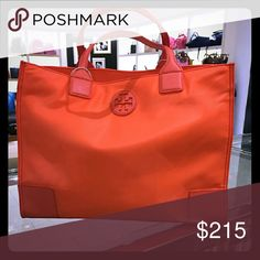 """Authentic tory burch orange nylon tote Brand new with tags tory burch nylon tote. This is a orange color and is authentic as it was purchased from Neiman Marcus and is currently sold out. Sorry no trades! Will ship same or next day!!  Nylon; patent leather trim. Golden hardware; tonal topstitching. Rolled tote straps, 7"""" drop. Open top; magnetic snap closure. Snap-button sides. Inside, one zip and two open pockets. Nylon lining. 13""""H x 17""""W x 6 1/2""""D  Will accept reasonable offers, PLEASE DO…"""