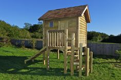 Our classic play area combines a play house with a #slide and seat swing.