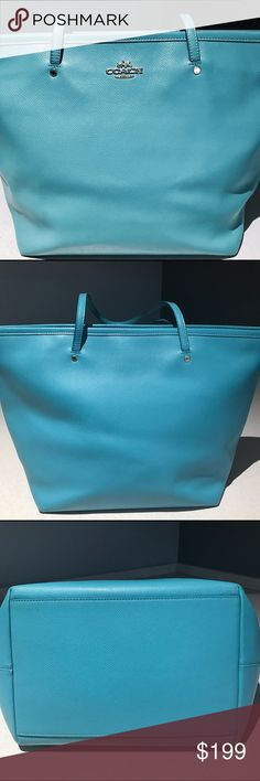 "Coach Tote In Leather Gold Hardware The color of this bag is more teal then blue. The first picture is the closest my camera is just not capturing the correct shade. A few signs of wear on the outside and the bottom of the inside. I personally think it looks amazing. 11 3/4"" L x 10 1/2"" H x 5 1/2"" D     9 1/2 double handle  drop. Zip closure inside has zip pocket and two multifunctional pockets. I think it's Cadet Blue I don't have the outside coach tag Coach Bags Totes"