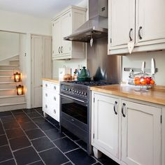 cream kitchen with slate floor | slate flooring, kitchen cabinetry