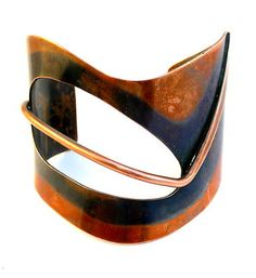 Huge abstract cuff by Art Smith. An African American who grew up in New York City, Smith took his inspiration from African tribal art and costume. He worked as a costume designer for several black dance companies in New York, which allowed him to experiment with his favorite theme: movement.
