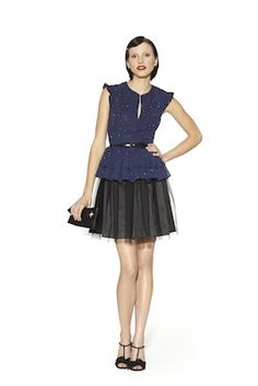 The Kate Young x Target Lookbook Is Here: Peplum Dress in Black/Navy with Belt ($69.99) Pearl Barrette in Gold ($14.99) Satin Clutch in Black ($19.99) T-Strap Sandals in Black ($39.99)