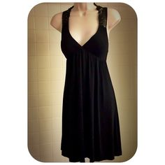 """Soft & Elegant Sleeveless Black Dress w/Lace Back This stunning soft & elegant sleeveless black v-neck dress features beautifully intricately designed lace straps that form the neckline & flow into the back lace panel. The bust is fitted  & below the bust, the dress flows freely, the empire waistline creating a flattering silhouette w/stunning detail. This dress is beautiful, so soft, comfortable & versatile-easily dressed up or down. Perfect summer dress!! The dress is 35"""" in length. The…"""