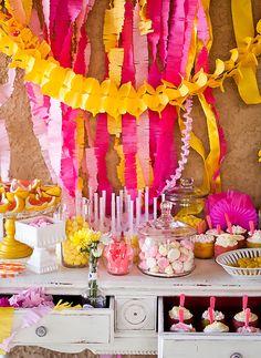 Dessert table at a pink lemonade summer birthday party
