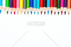 close-up shot of colored pencil arranged side by side over white. - Side by side arrangement of colored pencil over white background.