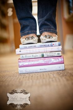 Cute shoes (or bare foot) on top of some great books!  For Lainey